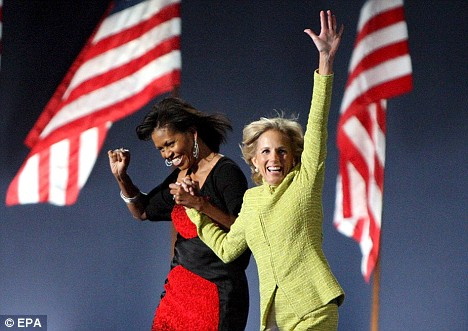 Michelle Obama and Jill Biden arrive onstage after Obama's acceptance speech in Chicago
