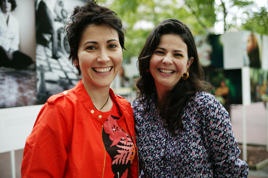 Giovanna Bonnelly (l.) and Nicole Sanchez pose in the midst of their outdoor show at City College called