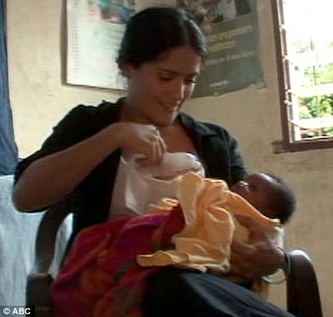 This is the moment Hollywood star Salma Hayek breast-fed an African baby while on a charity mission.