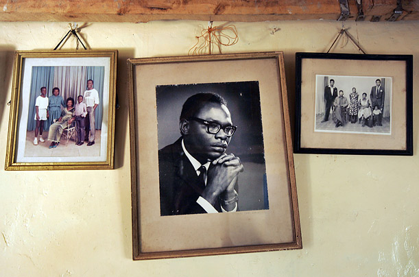 Born in Kenya, Barack Obama Sr. came to the University of Hawaii in order to study for a degree in economics. This photograph hangs on the wall of his stepmother's house in Kogelo, Kenya.