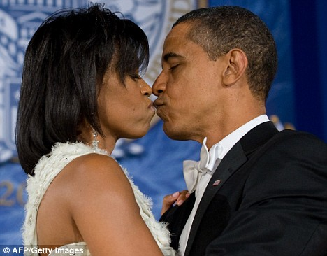 Mr President and the First Lady share a congratulatory kiss