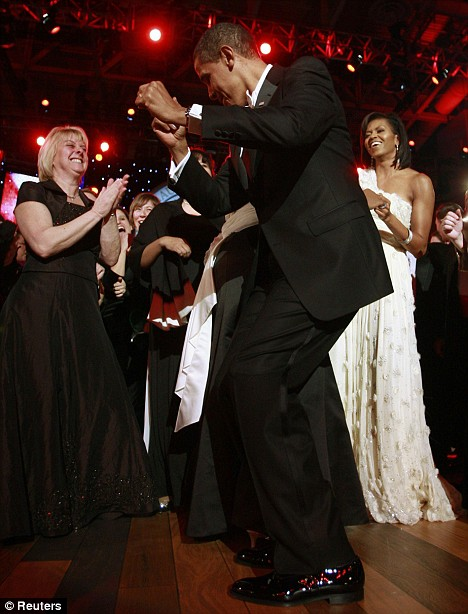 At last... a President who can dance: 'You can tell that's a black president,' joked comedian Jamie Foxx as Mr Obama broke loose on the dance floor