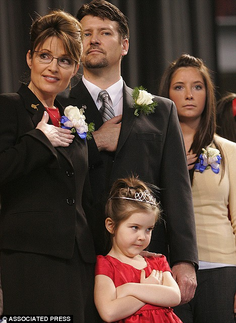 Working mother: Sarah Palin, husband Todd, and daughters Bristol, 17, and Piper, seven